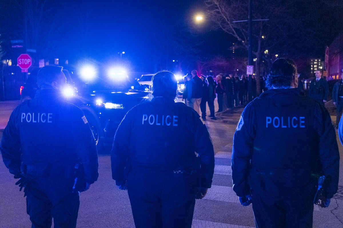 An ambulance carrying the body of a Chicago police officer who died of an apparent suicide arrives at the Cook County medical examiner's office on the Near West Side Friday night, March 5, 2021.