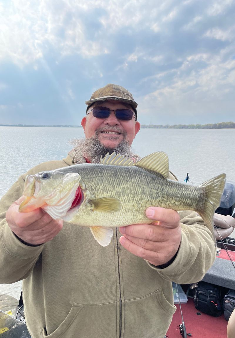 """Bob Evans from Marquette, Wisconsin  with a Fox Lake bass; guide Mike Norris texted, """"Notice how the color of this bass changed due to the dirty water."""" Provided photo"""