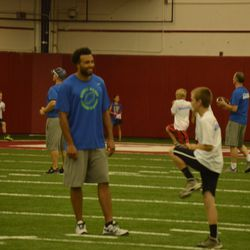Nick Toon (left) works with a camper.