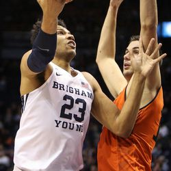 Brigham Young Cougars forward Yoeli Childs (23) lays the ball in under the arm of Idaho State Bengals center Novak Topalovic (13) as BYU takes on Idaho State at the Marriott Center in Provo on Thursday, Dec. 21, 2017.