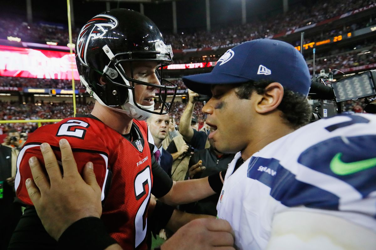 Matt Ryan of the Atlanta Falcons and Russell Wilson of the Seattle Seahawks meet on the field after the Atlanta Falcons win at the Georgia Dome on January 14, 2017 in Atlanta, Georgia.