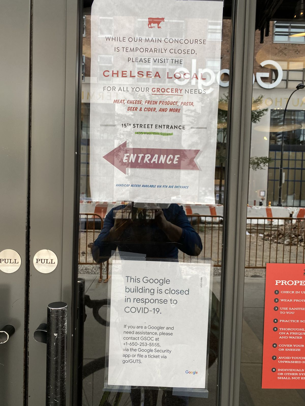Signs alert patrons to the closure of Chelsea Market's concourse