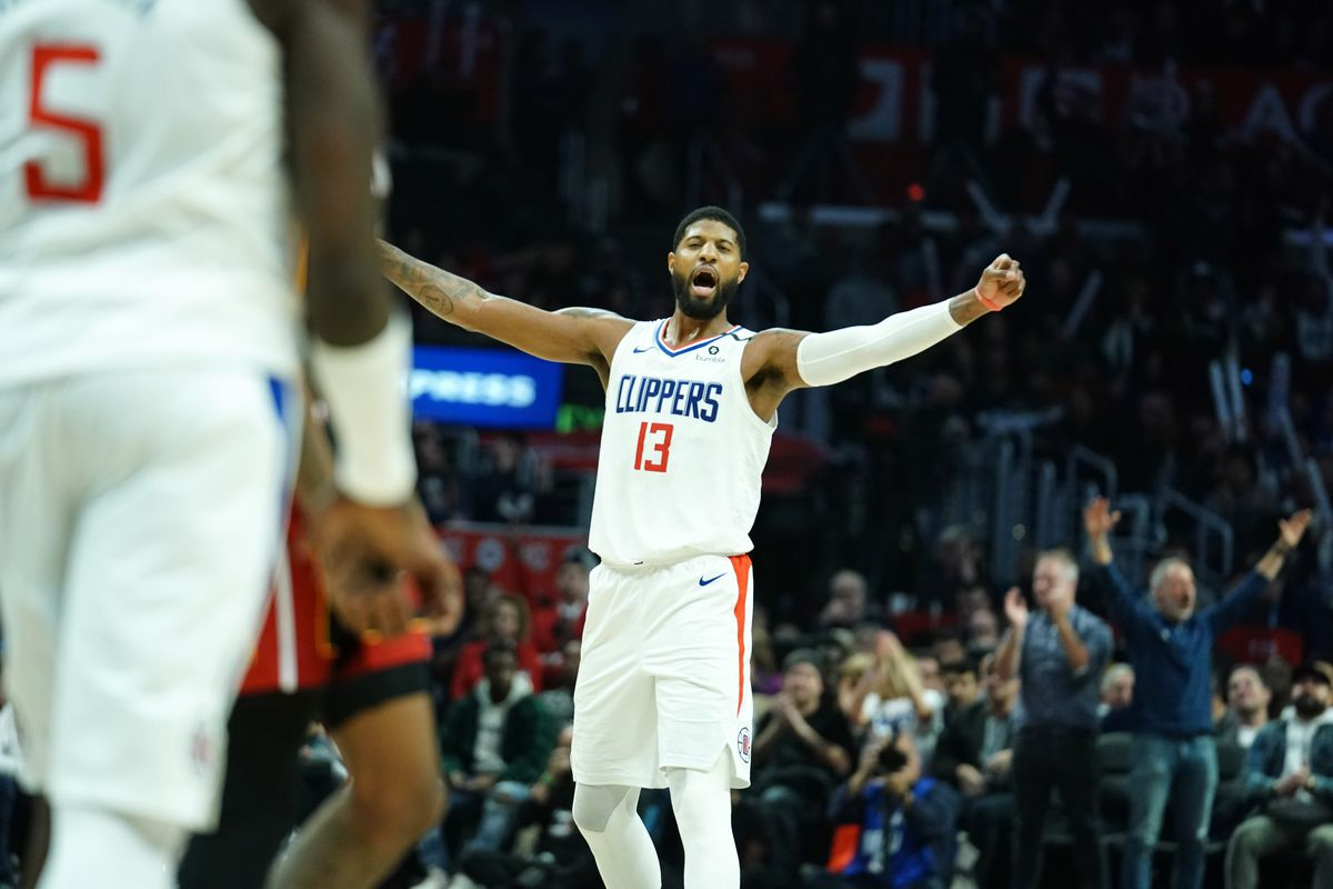 LA Clippers guard Paul George celebrates in the fourth quarter against the Miami Heat at Staples Center. The Clippers defeated the Heat 128-111.