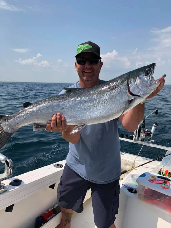 Chris Ranney holds his near-record coho caught out of Waukegan. Provided photo
