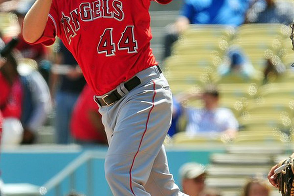 April 4, 2012; Los Angeles, CA, USA; Los Angeles Angels third baseman Mark Trumbo (44) hits a solo home run in the second inning against the Los Angeles Dodgers at Dodger Stadium. Mandatory Credit: Gary A. Vasquez-US PRESSWIRE