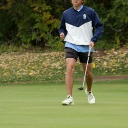 Skyline's Charlie Thompson reacts after sinking a long putt at the 5A boys state golf tournament at The Oaks at Spanish Fork in Spanish Fork on Tuesday, Oct. 5, 2021.