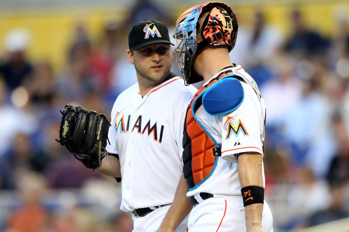 MIAMI, FL - JUNE 12:  Pitcher Mark Buehrle #56 of the Miami Marlins chats with catcher John Buck #14 against the Boston Red Sox at Marlins Park on June 12, 2012 in Miami, Florida.  (Photo by Marc Serota/Getty Images)
