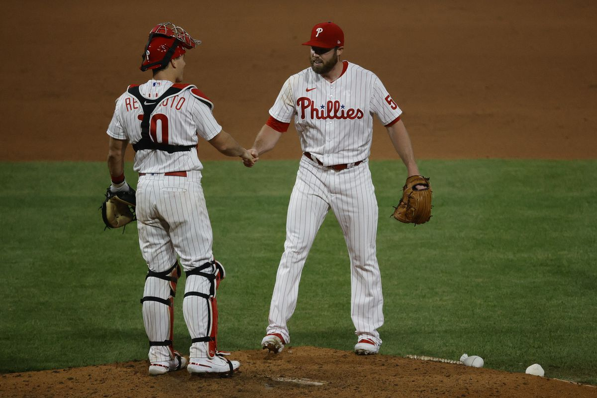 J.T. Realmuto #10 (L) and Sam Coonrod #54 of the Philadelphia Phillies celebrate after defeating the Milwaukee Brewers at Citizens Bank Park on May 04, 2021 in Philadelphia, Pennsylvania.