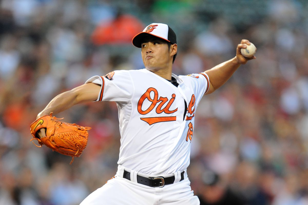 BALTIMORE, MD - AUGUST 14:  Wei-Yin Chen #16 of the Baltimore Orioles pitches during a baseball game against the Boston Red Sox on August 14, 2012 at Oriole Park at Camden Yards in Baltimore, Maryland.  (Photo by Mitchell Layton/Getty Images)