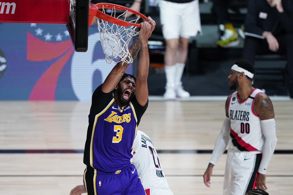 Anthony Davis of the Los Angeles Lakers reacts after scoring against the Portland Trail Blazers during the second half of Game Three of the first round of the playoffs between the Los Angeles Lakers and the Portland Trail Blazers at the AdventHealth Arena at the ESPN Wide World Of Sports Complex on August 22, 2020 in Lake Buena Vista, Florida.