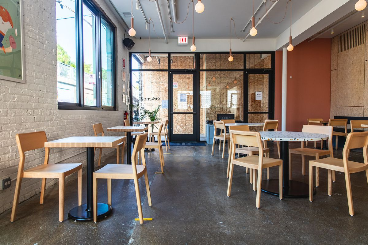 A basic cafe space with tables and chairs.
