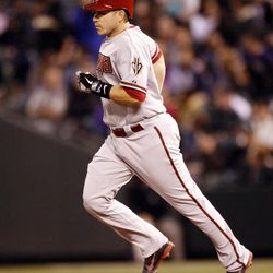 Arizona Diamondbacks' Miguel Montero rounds the bases after hitting a two-run home run off Colorado Rockies starting pitcher Juan Nicasio during the third inning of a baseball game on Friday, April 13, 2012, in Denver.