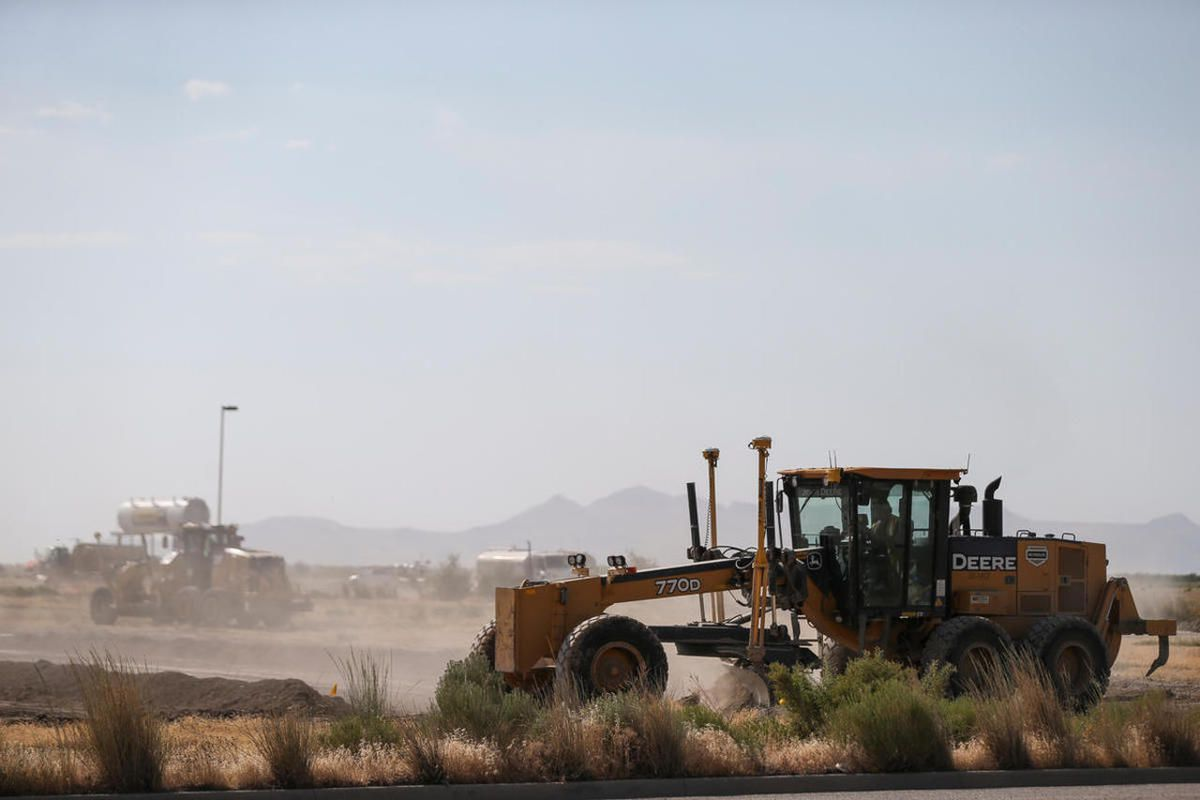 FILE - Crews work to place utility infrastructure on a lot that will be home to an Amazon fulfillment center on 5600 West in Salt Lake City on Wednesday, July 5, 2017.