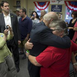 Vice President Joe Biden hugs Cathy Pool and her partner of over 20 years Mendy Yates, in the middle of the hug, as he visits a campaign field office, Saturday, Sept. 8, 2012, in Chilicothe, Ohio.