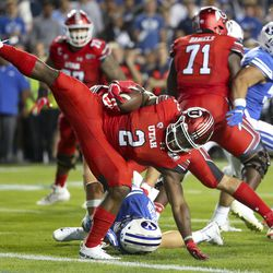 Utah running back Zach Moss (2) escapes safety after being hit by BSU linebacker Zeine Anderson, 23, during a Utah-BYU football game at LaVell Edwards football stadium in Provo on Thursday, August 29, 2019.