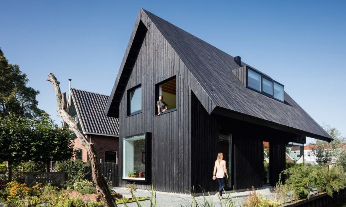 Modern Cottage Features Wow Worthy Burnt Timber Facade