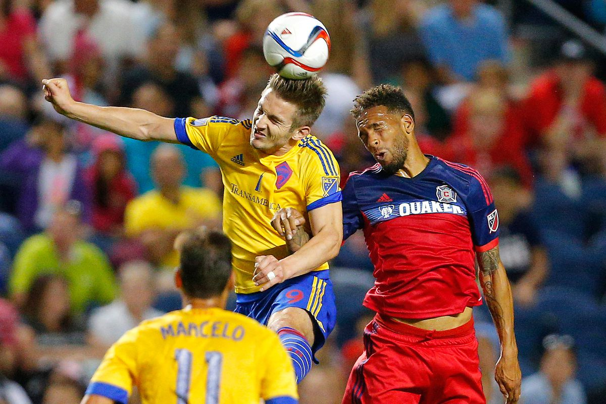 Colorado Rapids forward Kevin Doyle (9) and Chicago Fire midfielder Matt Watson (8) fight for the ball during the first half at Toyota Park.