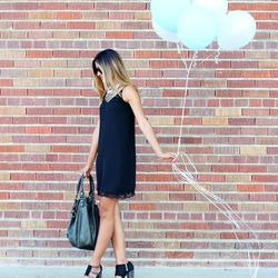 """Mel of <a href=""""http://melrodstyle.com""""target=""""_blank"""">MelRod Style</a> is wearing a Zara dress, Calvin Klein heels and a Balenciaga bag."""
