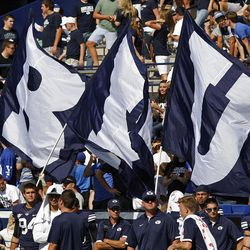 BYU flags after a touchdown as Brigham Young University defeats Weber State University in football 45-6 Saturday, Sept. 8, 2012, in Provo, Utah.