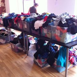 Bins of tees, tanks and knits. Mostly size small.
