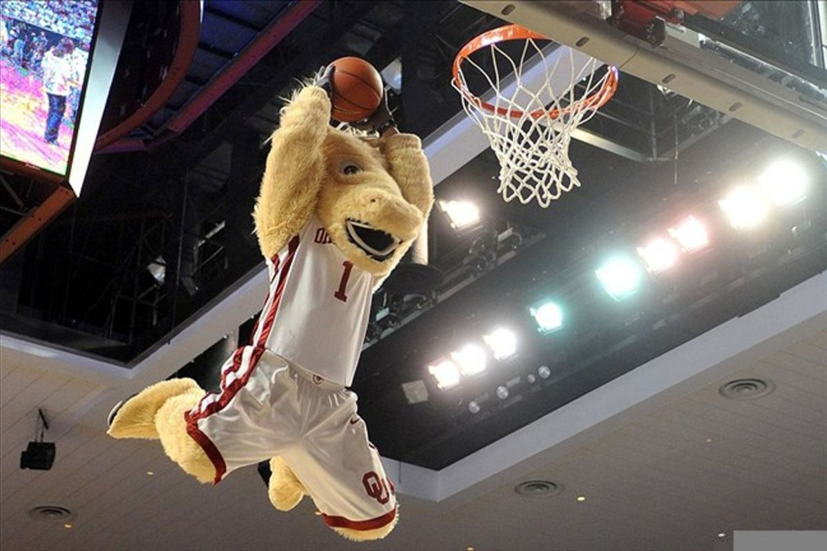 Mar 3, 2012; Norman, OK, USA; A member of the Oklahoma Sooners spirit team dunks the ball during a break in action against the Texas A&M Aggies during the first half at the Lloyd Noble Center. Mandatory Credit: Mark D. Smith-US PRESSWIRE
