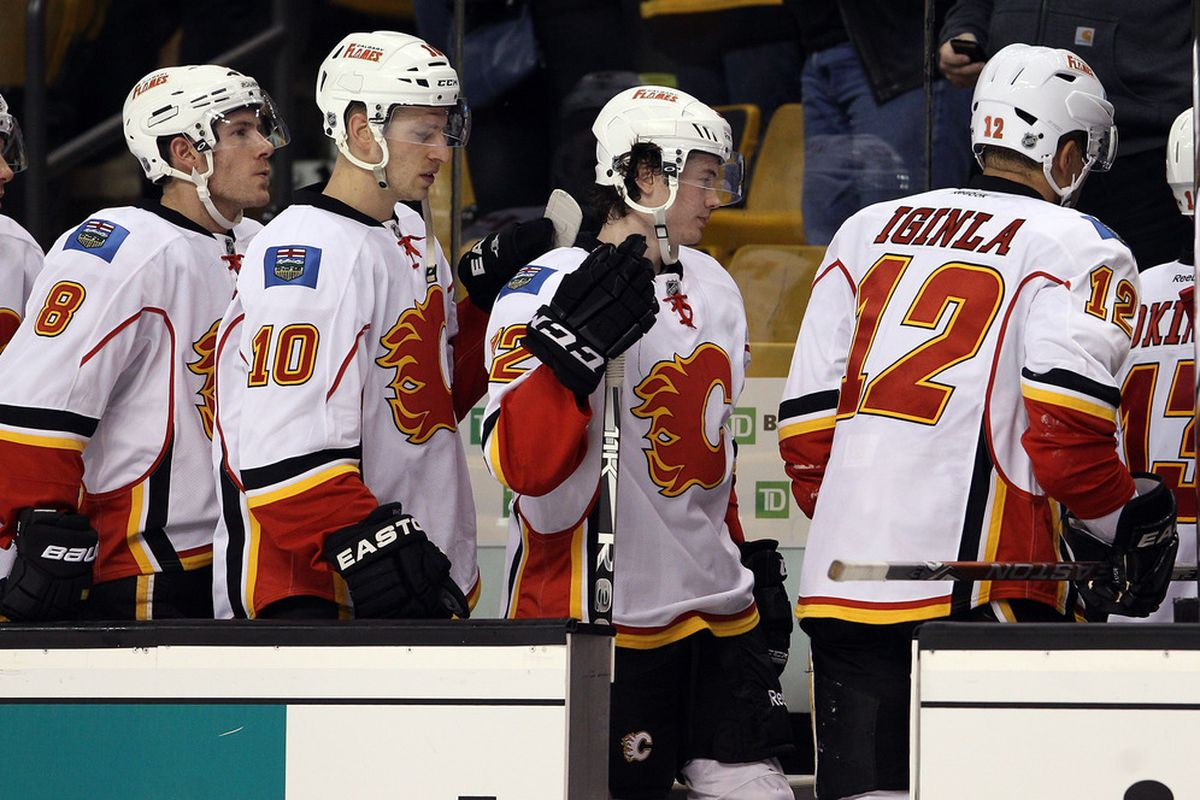 The Flames follow captain Jarome Iginla off the ice in Boston in January 2012.