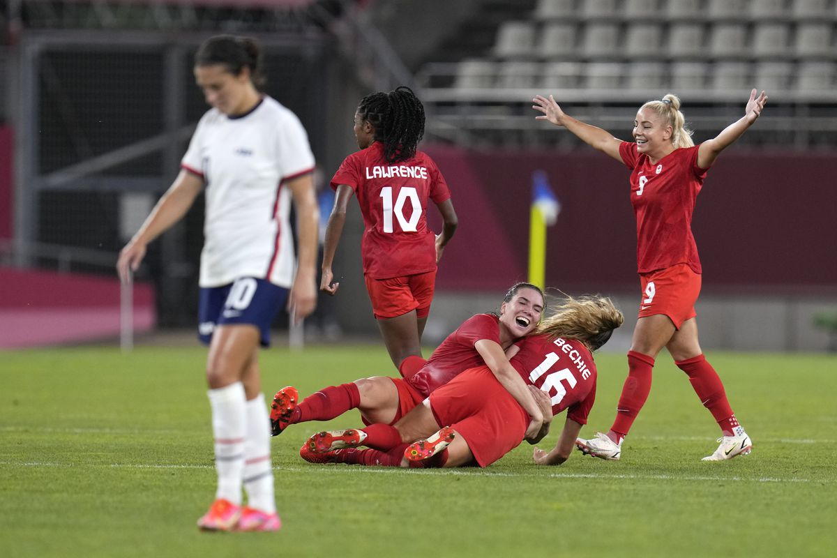 Canada's players celebrate after winning 1-0 over the United States during a women's semifinal match at the Tokyo Olympics.