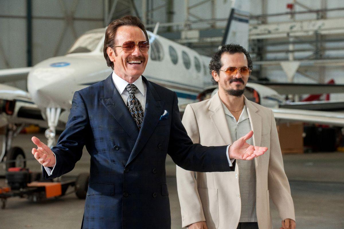"Bryan Cranston (left) stars as undercover U.S. Customs agent Robert Mazur and John Leguizamo portrays his partner Emir Abreu in ""The Infiltrator.""  Broad Green Pictures"