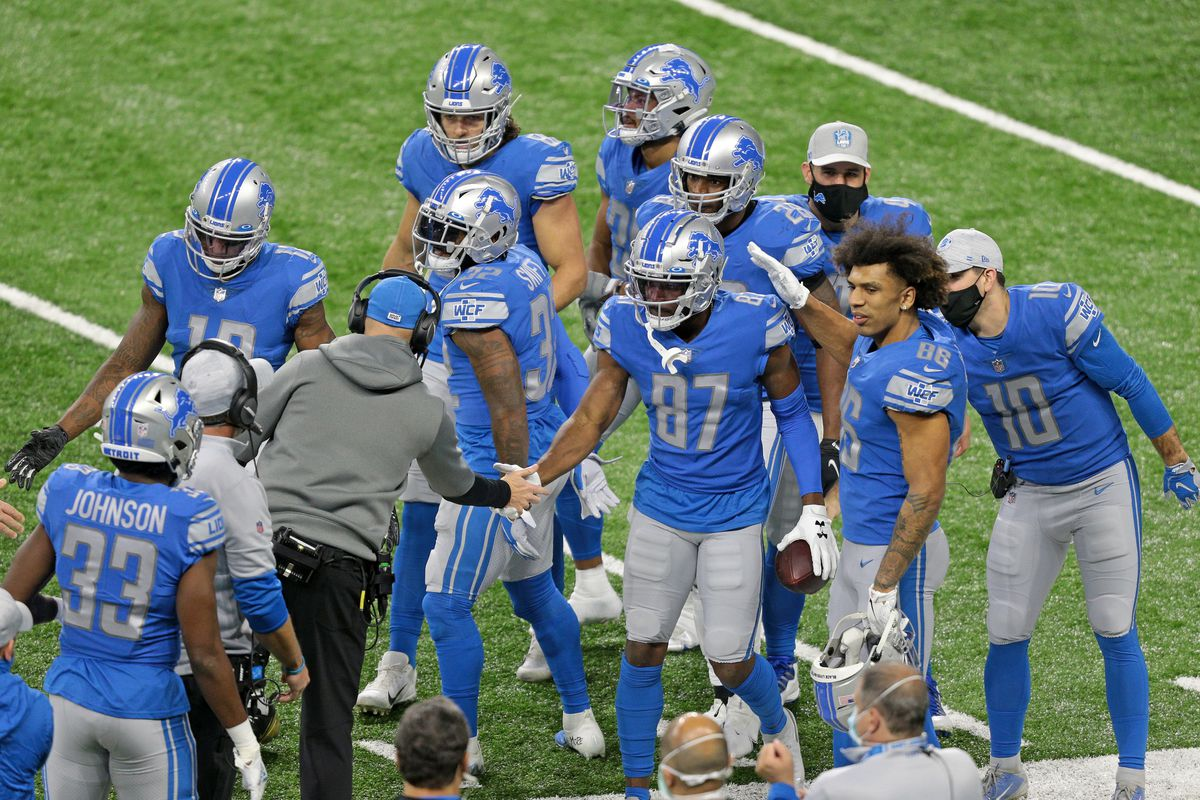 Detroit Lions wide receiver Quintez Cephus (87) is congratulated by interim head coach Darrell Bevell and teammates after scoring a touchdown during the first half of an NFL football game against the Minnesota Vikings in Detroit, Michigan USA, on Sunday, January 3, 2021.