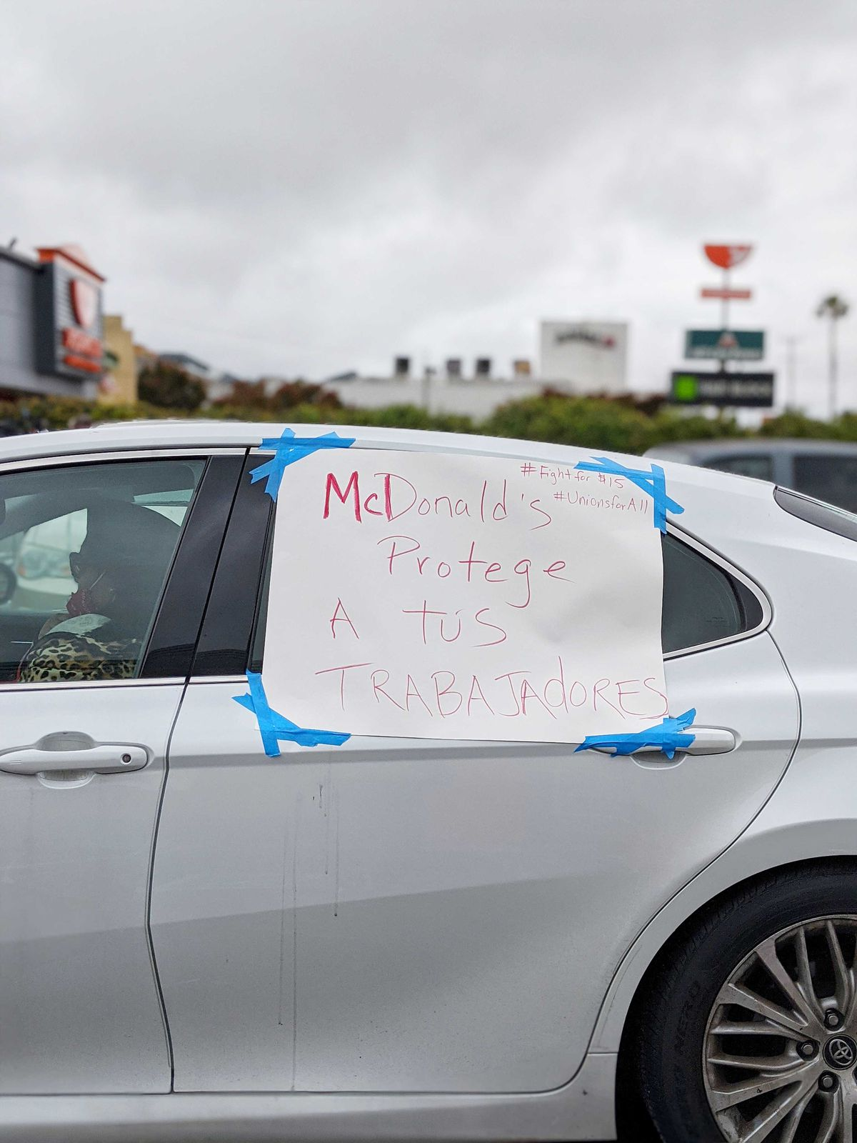 Protest sign taped to a car in Spanish at a South LA McDonald's on April 6, 2020