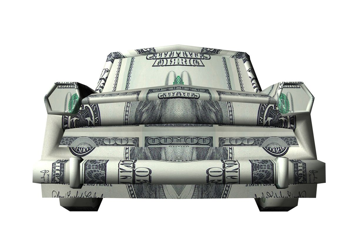 An origami car made of paper money.