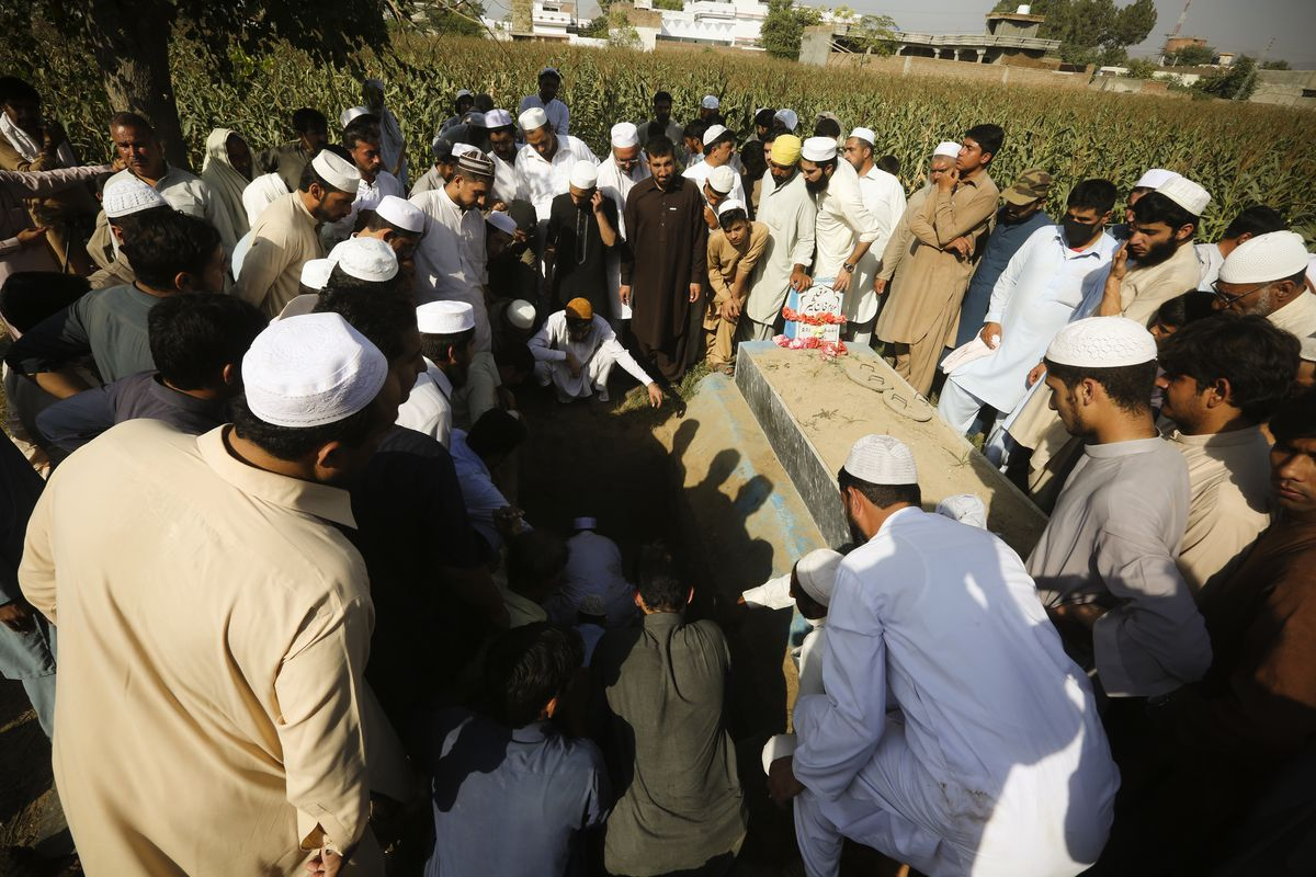 Pakistani villagers attend the funeral of journalist Haroon Khan in Swabi, Pakistan, on October 13, 2017. The Pakistani Taliban said in a statement that its gunmen killed Khan, without providing any evidence.