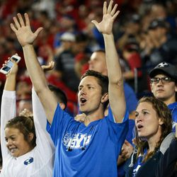 Brigham Young Cougars fans cheer during the game against the Utah Utes at LaVell Edwards Stadium in Provo on Saturday, Sept. 9, 2017.