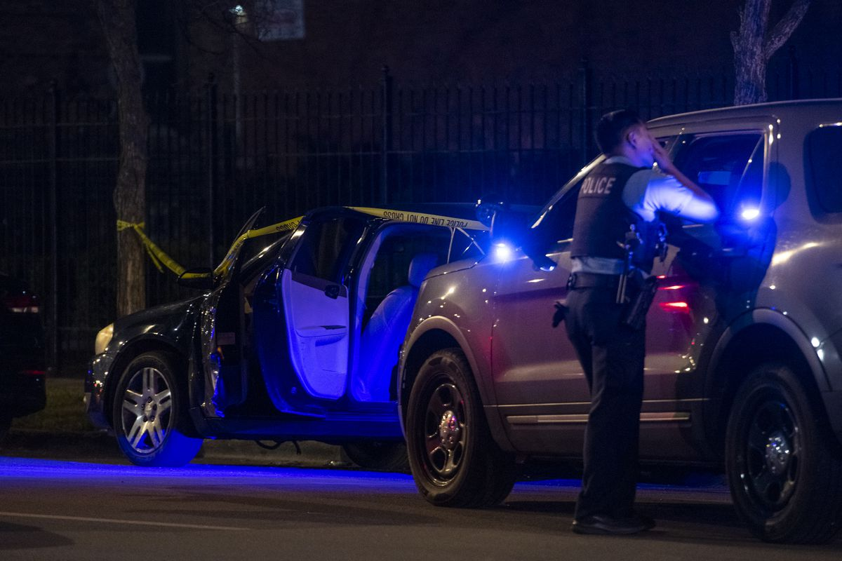 Chicago police at the scene where a vehicle struck and injureed a police officer at in the 6300 block of South Michigan Avenue.