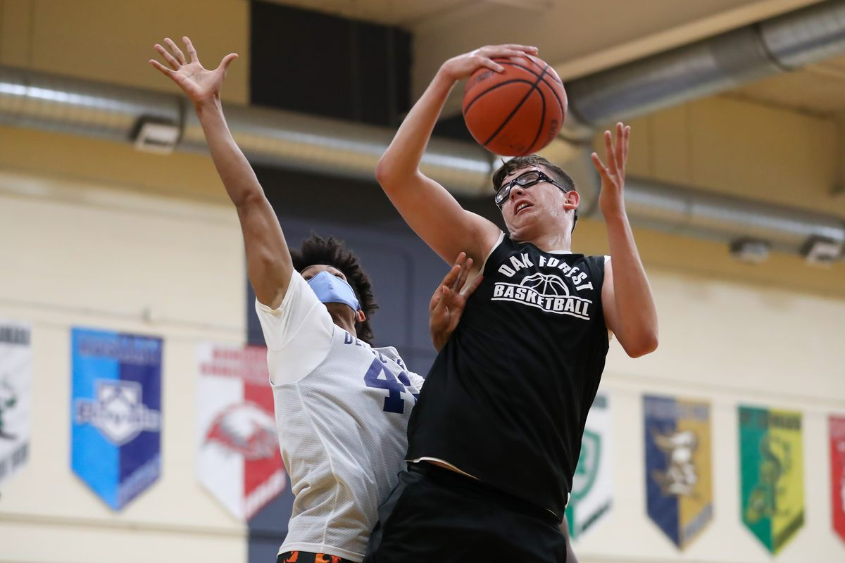 Oak Forest's Robbie Avila (21) controls the ball against DePaul Prep during the Riverside Brookfield Summer Shootout.