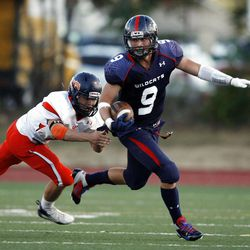 Woods Cross' #9 Sean Baton, right, runs away from Mountain Crest's #9 Troy Netsley as they play Friday, Aug. 31, 2012.