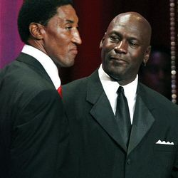 Basketball Hall of Fame inductee Scottie Pippen, left, stands with former teammate Michael Jordan during the enshrinement ceremony in Springfield, Mass., Friday.