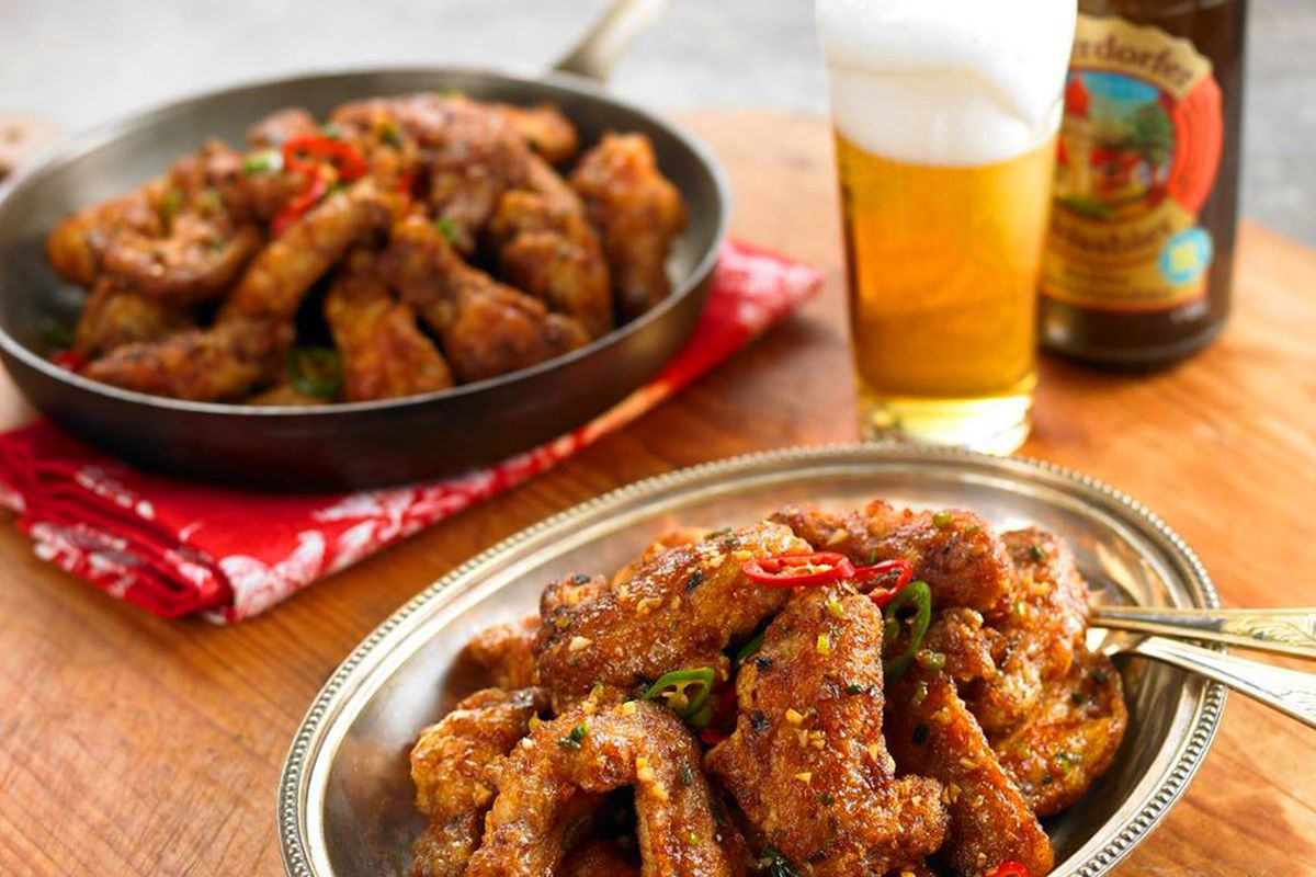 Two plates of Korean-inspired chicken wings at BB.Q Chicken, headed to Chinatown's Shanghai Plaza.