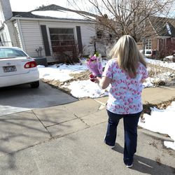 Nicole Maynes, a certified nursing assistant for Visiting Angels, arrives at the home of Janet Janis, a client of the in-home senior care company, prior to surprising her with flowers and hugs in Salt Lake City on Wednesday, Feb. 12, 2020. Visiting Angels is delivering hugs to their clients the week of Valentine's Day.