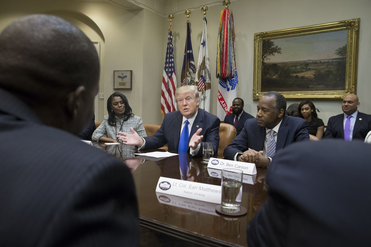 4160a599ee0 President Donald Trump holds an African American History Month listening  session attended by nominee to lead the Department of Housing and Urban  Development ...