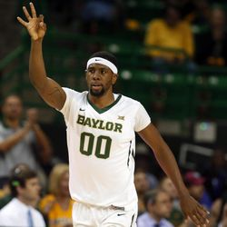 Baylor forward Royce O'Neale (00) reacts to his three-point shot over Kansas State in the first half of an NCAA college basketball game, Saturday, Feb. 21, 2015, in Waco, Texas. (AP Photo/Rod Aydelotte)