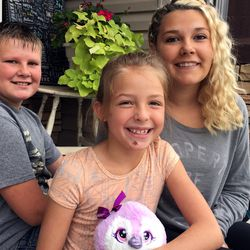"""Braxton Blanchard, left, and Bailey Blanchard, right, are being praised for helping their cousin, 8-year-old Opal Henley, escape an attack by a pit bull while Opal and Braxton were walking to school Monday, Sept. 28, 2015, in Roosevelt. Opal suffered extensive injuries to her legs in the attack, as well as a chipped front tooth and """"road rash"""" on her chin."""