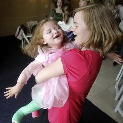 Whitnee Stoddard is spun around by her sister, Kortenee, during the Princess Party.