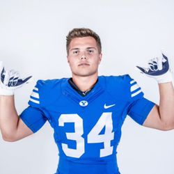 Josh Wilson poses for a photo in BYU gear.