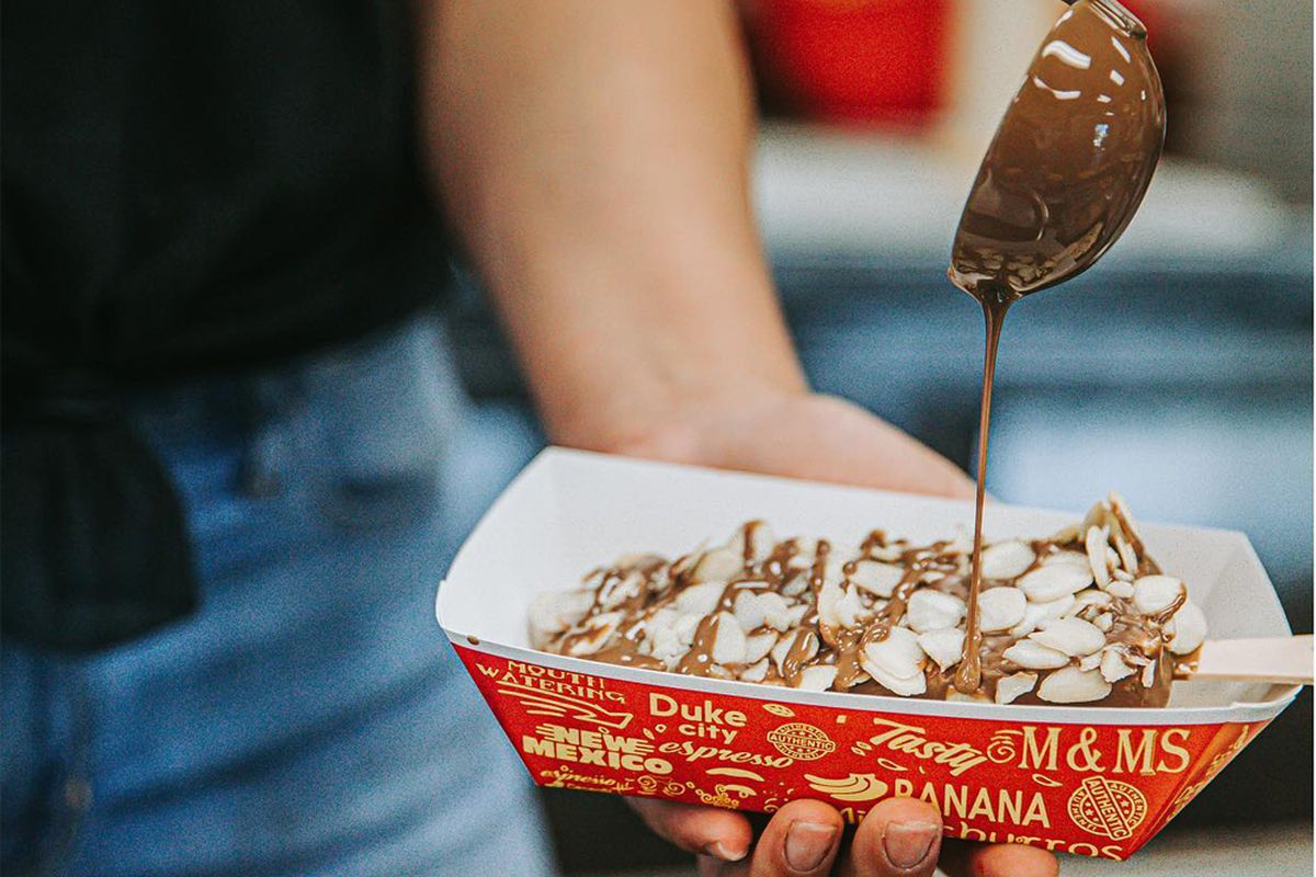 Drizzling chocolate on gourmet Mexican popsicles at The Paleta Bar, headed to Chinatown.
