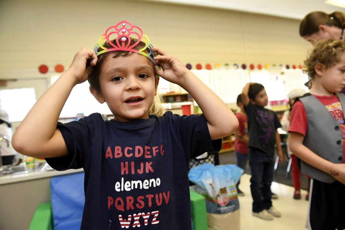 Ivan Ramirez Boyes, 5, plays dress-up during play time in the kindergarten class of Jenny Magee at University Hill Elementary School in Boulder.