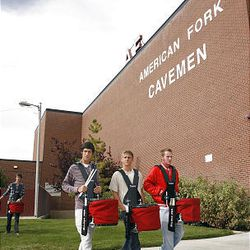 Members of the American Fork High Marching Band drum line walk out of the band room to practice for the the funeral of American Fork High band instructor Heather Christensen, who was killed in a bus accident on their way back from a band competition in Idaho over the weekend.