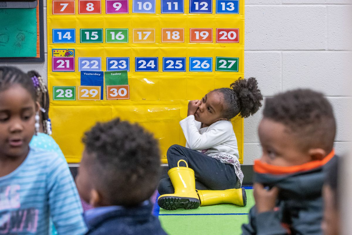 Haadiyah Muhammad, 5, watches as Isaac Black III, a teacher at Avondale Meadows YMCA Early Learning Center, gives a lesson on the number seven.