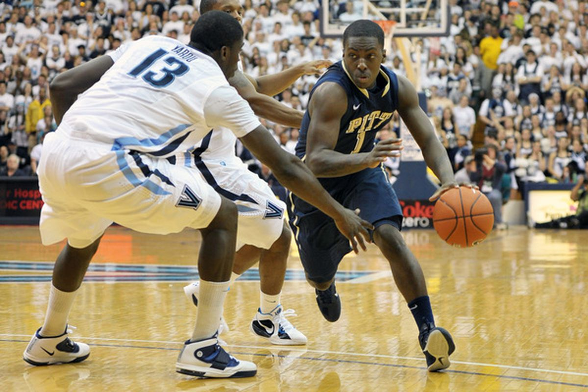 VILLANOVA PA - FEBRUARY 12: Travon Woodall #1 of the Pittsburgh Panthers drives around Mouphtaou Yarou #13 of the Villanova Wildcats at The Pavilion on February 12 2011 in Villanova Pennsylvania. (Photo by Drew Hallowell/Getty Images)