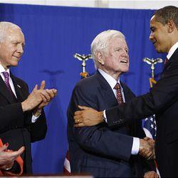 President Barack Obama embraces Kennedy as bill co-sponsor Orrin Hatch, R-Utah, and Sen. Barbara Mikulski, D-Md., watch before Obama signed the Edward M. Kennedy Serve America Act on April 21.